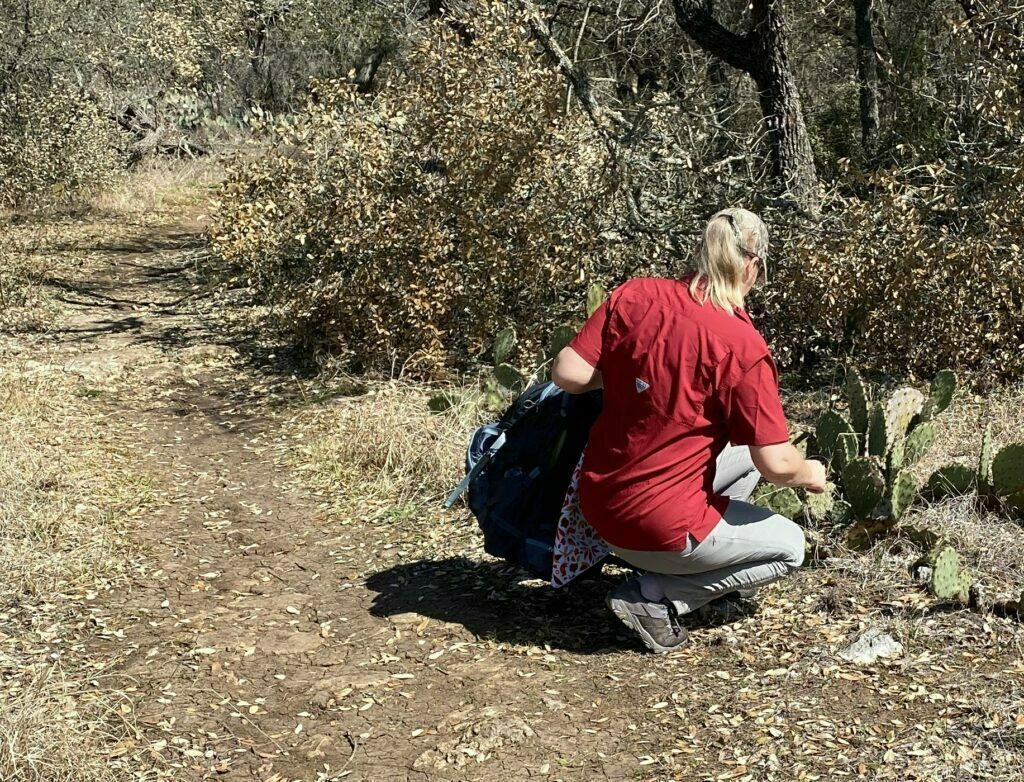 Nutty Hiker checking out some cacti in her Kuhl Trekr Pants