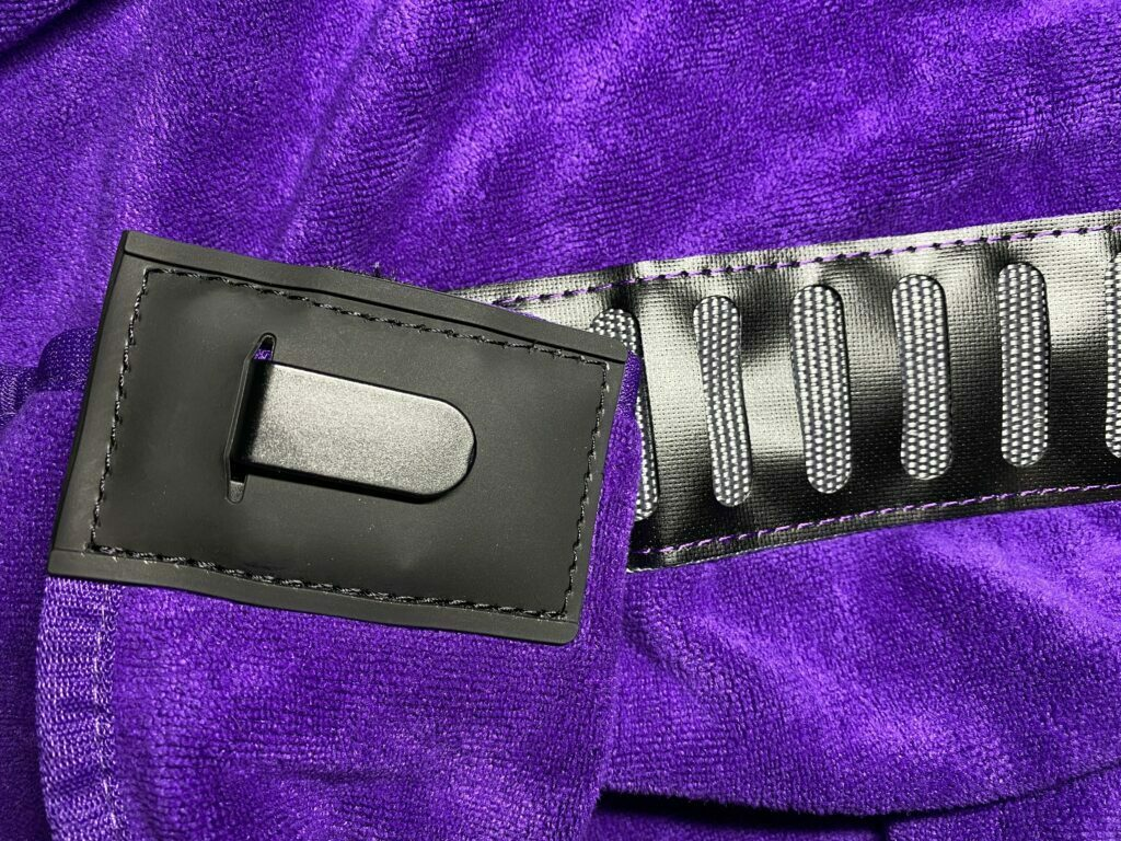 Close up of the Orange Transition Wrap belt-type system with a secure clip