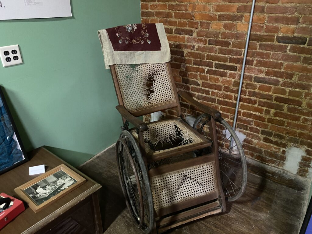 Trans-Allegheny old wheel chair in room