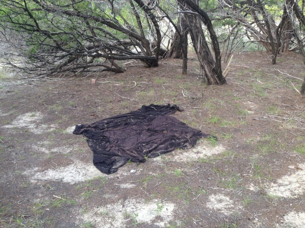 Black Bed Sheet found off the trail at Dana Peak Park near Fort Hood Texas